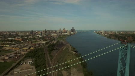 motor vehicle : Detroit Aerial v84 Flying low over Ambassador Bridge panning right with cityscape views. Stock Footage