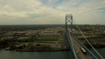 windsor : Detroit Aerial v89 Flying low over Ambassador Bridge panning right with cityscape views.