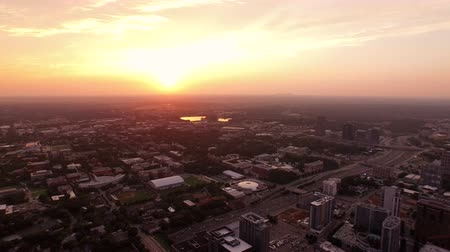 panoramic view : Atlanta Aerial v71 Flying over downtown panning right with sunset and Midtown views. Stock Footage