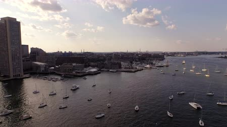 area of port : Boston Aerial v40 Flying low over inner Boston Harbor panning left with cityscape views. Stock Footage
