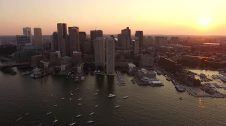area of port : Boston Aerial v57 Flying low over harbor with sunset cityscape views. Stock Footage