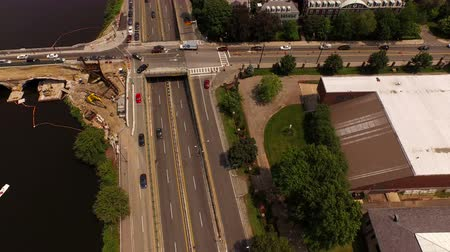 cambridge : Boston Aerial v108 Flying low backwards over Harvard campus panning down. Stock Footage