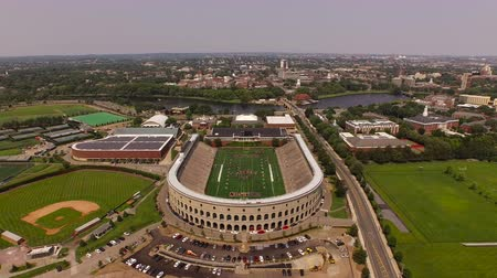 futbol : Boston Aerial v114 Flying backwards over Harvard campus with stadium and athletic area views.