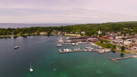 traverse : Harbor Springs Aerial v6 Flying low backwards panning left over harbor. Stock Footage