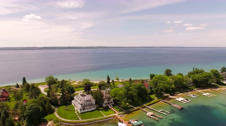 traverse : Harbor Springs Aerial v12 Flying low over peninsula panning right. Stock Footage