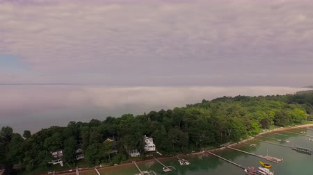 traverse : Harbor Springs Aerial v15 Flying low besides peninsula panning left. Stock Footage