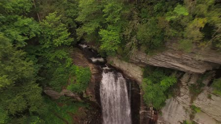 looking : Waterfalls Aerial v6 Flying backwards and up from Looking Glass Falls in North Carolina.