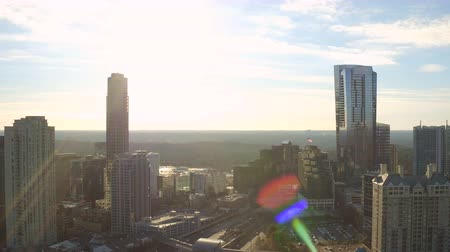 samochody : Atlanta Aerial v147 Flying backwards over Buckhead downtown panning with cityscape views at sunrise. Wideo