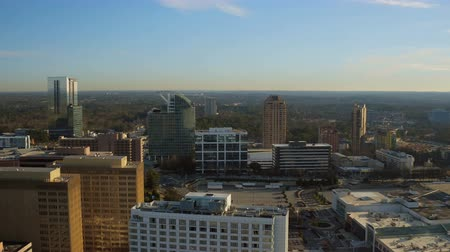 samochody : Atlanta Aerial v152 Flying over Buckhead downtown panning with cityscape views at sunrise. Wideo