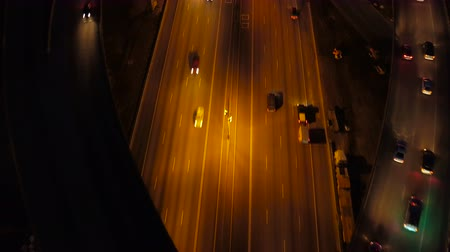 construir : Atlanta Aerial v231 Panning down to vertical shot over Spaghetti Junction freeways following at night, pan up. Stock Footage