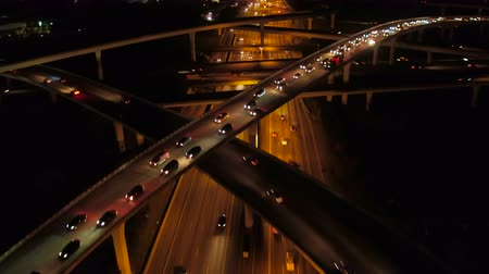 вниз : Atlanta Aerial v233 Flying low backwards following over Spaghetti Junction freeways at night, pan down.