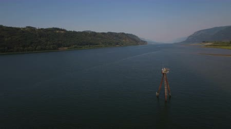 ravina : Columbia River Aerial v5 Flying low around large river channel marker. Stock Footage