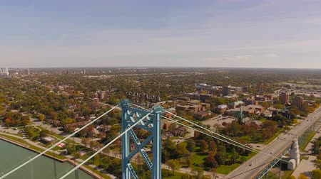 windsor : Detroit Aerial v101 Flying low over Ambassador Bridge panning with cityscape views. Stock Footage