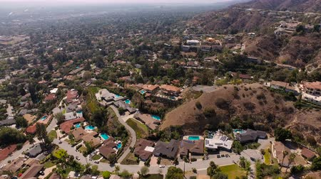 kopec : Glendale Aerial v1 Flying over luxury neighborhood in the hills panning down.