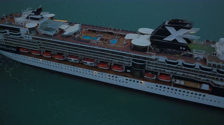 batı : Key West Aerial v5 Flying low over cruise ship departing panning up. Stok Video