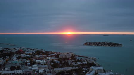 запад : Key West Aerial v7 Flying low over town panning at sunset.