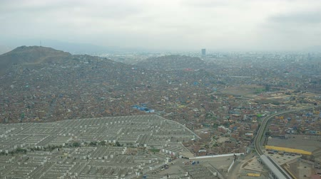 el train : Lima Peru Aerial v47 Flying near large cemetery in El Agustino district panning with panoramic views.