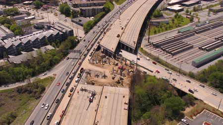 eu : Atlanta Aerial v284 Flying low backwards panning up from freeway bridge collapse with cityscape views 417