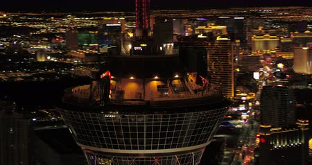 stratosphere : Las Vegas Aerial v38 Closeup shot panning around Stratosphere tower at night with panoramic views 417 Stock Footage