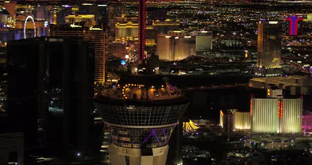 stratosphere : Las Vegas Aerial v39 Closeup shot panning around Stratosphere tower at night with panoramic views 417 Stock Footage