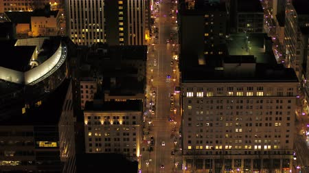Орегон : Portland Aerial v97 Birdseye view flying low over downtown street at night 417