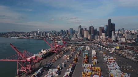 construction crane : Seattle Aerial v91 Flying low over shipyard with cityscape views 417 Stock Footage