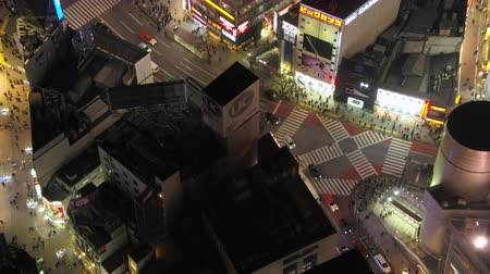 tokyo station : Japan Tokyo Aerial v21 Birdseye view flying low around famous Shibuya intersection area night 217 Stock Footage
