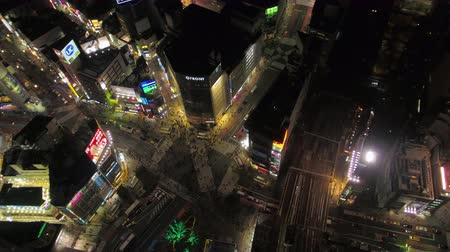 tokyo station : Japan Tokyo Aerial v24 Birdseye view flying around famous Shibuya intersection area night 217