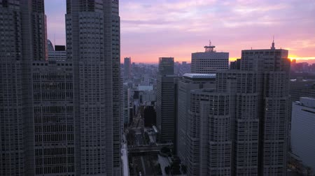 ingázó : Japan Tokyo Aerial v28 Flying low up between buildings in downtown Shinjuku sunrise 217