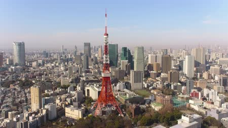 minato : Japan Tokyo Aerial v33 Flying low backwards away from Tokyo tower with cityscape views Stock Footage