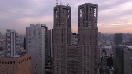 tokyo government : Japan Tokyo Aerial v31 Flying low up between buildings panning in downtown Shinjuku sunrise 217