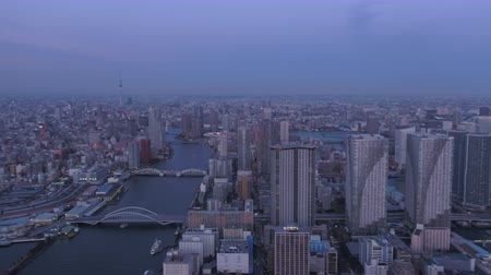 chuo city : Japan Tokyo Aerial v45 Flying over harbor panning at dusk with cityscape views Stock Footage