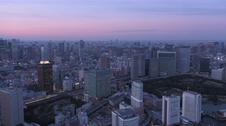 chuo city : Japan Tokyo Aerial v44 Flying over harbor panning at dusk with cityscape views Stock Footage