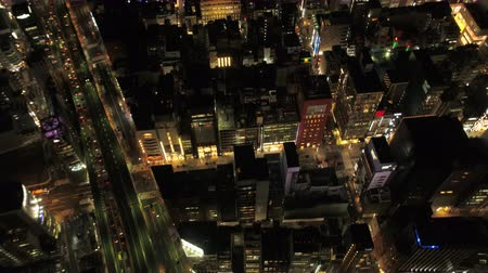 chuo city : Japan Tokyo Aerial v50 Birdseye view flying low over Ginza area panning night 217