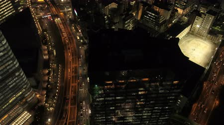 chuo city : Japan Tokyo Aerial v52 Vertical shot panning up to cityscape views in Ginza area night 217
