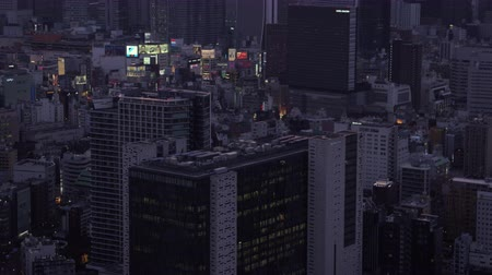 tokyo government : Japan Tokyo Aerial v63 Shinjuku birdseye view flying low panning up to downtown cityscape dusk 217 Stock Footage