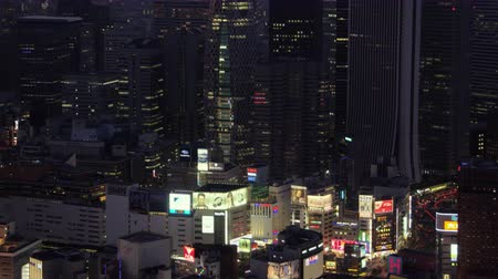 cocoon : Japan Tokyo Aerial v67 Flying low around famous Shinjuku area panning up at dusk 217