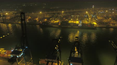 ithalat : Hong Kong Aerial v66 Flying low over large shipyard terminal panning at night 217 Stok Video