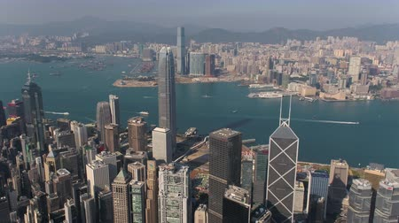 низкий : Hong Kong Aerial v74 Flying over Central District towards Kowloon with cityscape views 217 Стоковые видеозаписи