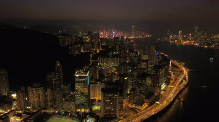 inspire : Hong Kong Aerial v82 Flying backwards over Quarry and Kowloon Bay with cityscape views at night 217