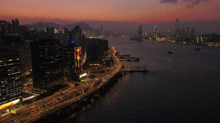 склон холма : Hong Kong Aerial v81 Flying low along North Point with cityscape views at dusk 217