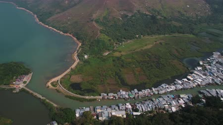 slum house : Hong Kong Aerial v95 Birdseye view flying over Tai O fishing village area panning