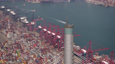 palmo : Hong Kong Aerial v106 Closeup birdseye flying around Stonecutters Bridge pole tower with shipyard views 217 Vídeos