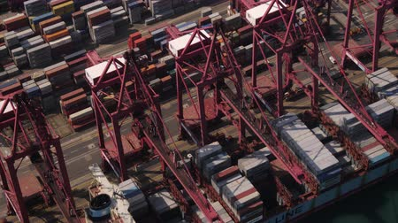 tesisler : Hong Kong Aerial v108 Closeup birdseye view around and over large cargo ship unloading 217