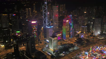kerület : Hong Kong Aerial v132 Flying low around skyscrapers in downtown Central area at night 217 Stock mozgókép