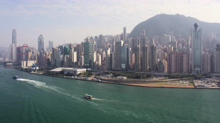 ferry terminal : Hong Kong Aerial v170 Flying low over Victoria Harbour with cityscape views