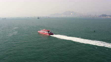 follow shot : Hong Kong Aerial v173 Flying low around ferry boat headed to Macau