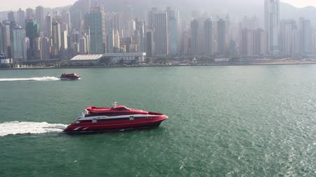 follow shot : Hong Kong Aerial v174 Flying low around ferry boats headed to Macau with cityscape views 217