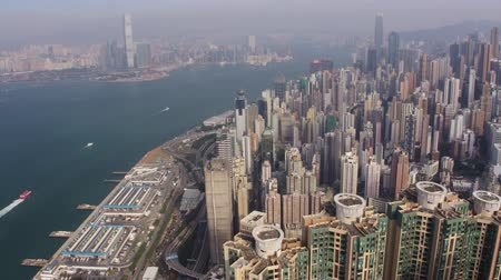 birdseye : Hong Kong Aerial v175 Flying over condominium complex panning with cityscape views