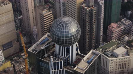 crossing road : Hong Kong Aerial v182 Cineflex closeup view flying around building Stock Footage
